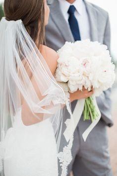 The prettiest lace veil, a peony bouquet and the stunning couple: http://www.stylemepretty.com/florida-weddings/naples-fl/2015/08/19/romantic-yacht-club-wedding/   Photography: Hunter Ryan Photo - http://hunterryanphoto.com/