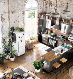 Converted warehouse makes for a stunning loft apartment. Exposed brick walls are… Converted warehouse makes for a stunning loft apartment. Exposed brick walls are soften with loads of indoor plants and timber furniture. Living Room Interior, Home Interior Design, Interior Decorating, Decorating Ideas, Decor Ideas, Living Rooms, Loft Apartment Decorating, Interior Ideas, Kitchen Interior