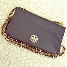 Navy Blue Tory Burch Crossbody Beautiful navy blue Crossbody purse with gold accents.  Chain strap. Two areas to organize items. Perfect for a quick night out on the town and easy to grab items out of. A few scratches on the clasp as illustrated in the pictures. The one thing that needs to be readjusted is the strap with the fabric weaving in and out. The fabric can be taken off or redone to make this perfect again. Tory Burch Bags Crossbody Bags