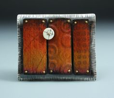 """Deb Karash 1962 """"Truth"""" Brooch in sterling silver, copper, brass, antique ivory piano key, and prismacolor."""