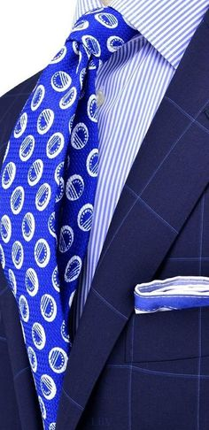 The Blues...always good. Monochromatic take on business dressing: blue tie, blue striped shirt, blue accented pocket square, blue suit...very sharp and not quite as easy to pull off as it looks here..well done.