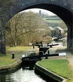 Parkhead Locks, Dudley canal. 20/02/05. In background: Blowers Green Pumping Station & Netherton Church. By David M. Lear