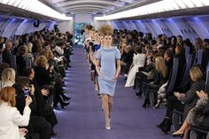 only Karl Lagerfeld would put a Chanel show in an airplane and make it work