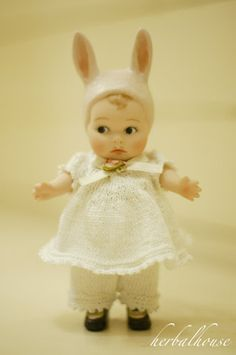 baby doll or figurine with bunny ears