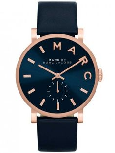 #unisexwatch - 18% OFF  A classy strap watch from Marc By Marc Jacobs with a modern and stylish finish. A stainless steel case with rose gold plating holds the attractive blue dial featuring complementary rose details and a seconds sub-dial.