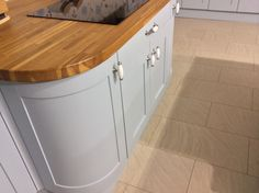 London N10 Sexy curved Shaker Base unit finished in Dove Grey with 40mm Solid Oak worktops