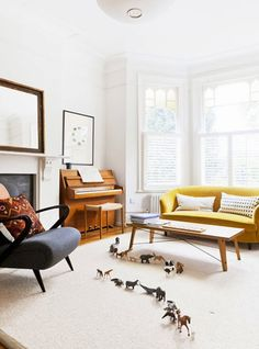 Love the yellow couch and b&w pillows!   What a light and airy room...full of possibilities for the day.