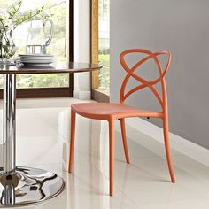 Enact Dining Side Chair, Orange - Enjoy bursts of creativity and bouts of exuberance with the Enact Modern Dining Side Chair. Designed with an inspired back pattern and fluid molded plastic arm and seat construction, Enact is a progressive piece perfect for modern dining rooms, kitchens, and casual seating areas. The Enact Modern Dining Side Chair features non-marking feet, comes fully assembled and stackable, and easily wipes clean. Set Includes: One - Enact Dining Side Chair. Material…