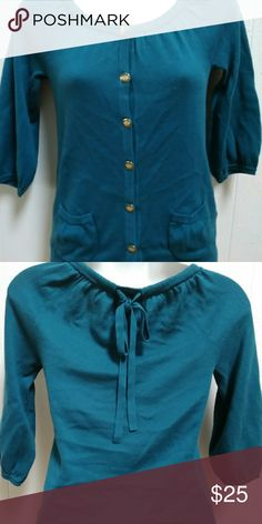 Juicy Couture sweater Juicy Couture sweater gently used in excellent conditions back has a string lace bow. Color teal Juicy Couture Sweaters Cardigans
