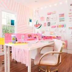 love the striped wallpaper installation and the pegboard wall