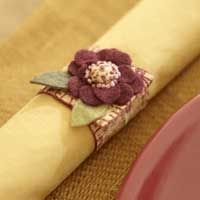 Stitch a set of whimsical embroidered napkin rings in time to decorate for tonight's dinner party. Each ring takes less than 30 minutes to complete and is a great project for using up small felt and fabric scraps. Free templates!