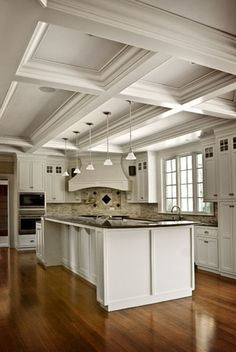 Beautiful white kitchen with heavy coffered ceiling