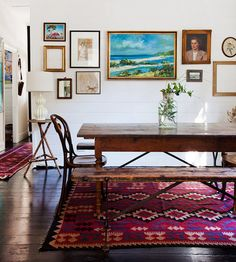 I love the contrast of a deep coloured rug with natural wood pieces