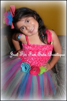 This precious colorful tutu dress is hand made designed along with a cute headband and is great for any occasion. This Beautiful tutu dress is
