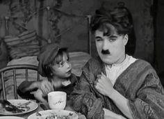 Charlie Chaplin & Jackie Coogan, kiss the doggie:  The Kid, 1921