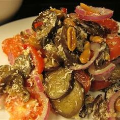 Marinated Eggplant and Tomato salad with coconut and Peanuts..   Adventurous!