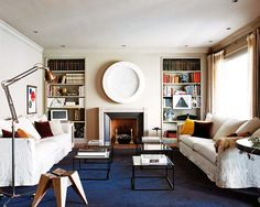 I love how the oceanic blue carpet anchors this neutral living room.