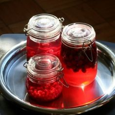 Festive fruit-infused liquor, perfect for Christmas gifts or parties.  Cranberry vodka, pomegranate gin, and red currant vodka.