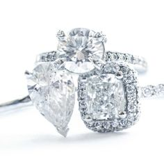 Trio of Custom Made Engagement Rings featuring a Classic 2 carat Pear Shaped Diamond, a carat Cushion Halo Engagement Ring, and a carat Round Brilliant Cut Diamond with Pave Diamonds. Custom Made Engagement Rings, Halo Engagement, Cushion Halo, Thing 1, Custom Jewelry Design, Pear Shaped Diamond, 2 Carat, Fine Jewelry, Diamonds