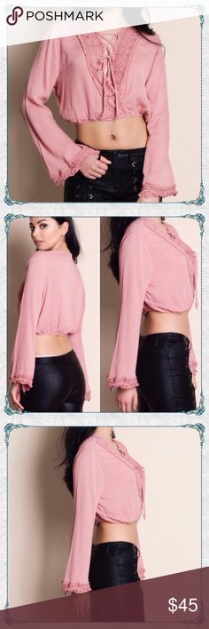 ✨Coming this Week✨Lace-up Bell Sleeve Crop Top 🌾Lace-up Bell Sleeve Cropped Blouse               ✨beautiful cut and crosses over several looks -easily dress up or dress down                              ✨like this listing for arrival notice - only 1 of each size coming - You may claim one in the comments. I can make a reserved listing 😊 Aluna Levi Tops Crop Tops