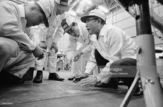 At a research and development facility, Japanese industrialist and founder of Honda corporation, Soichiro Honda (1906 - 1991) (right) talks with engineers about a solution to an automobible body noise problem, Tokyo, Japan, 1967.