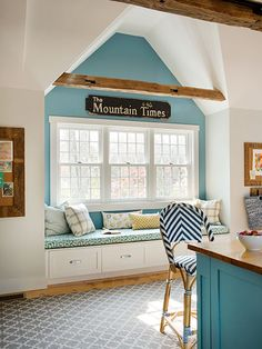 Talk about wow! Turquoise blue behind the window seat in this cathedral-ceiling kitchen echoes the slightly darker color on the island.