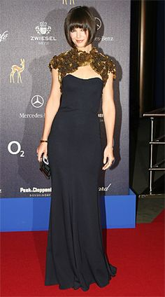 Katie Holmes when she had that gorgeous, China-doll hair cut. Love the contrasting yet opulent shrug over a simple LBD.