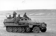German troops observing the field in a SdKfz. 251 halftrack vehicle, southern Russia, Aug 1942