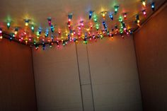 cardboard forts for kids | Cardboard fort with Christmas lights!