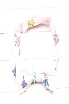 Available in infant size andYou can find Knit headband and more on our website. Knit Headband, Baby Headbands, Princess Disney, Baby Size, Baby Knitting, White Shorts, Infant, Website, People