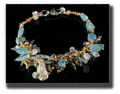 """""""Rainforest"""", The disappearing and complex life forms of the Earth's rainforests is portrayed in spectacular fashion in this necklace. Translucent Aquamarine reminds us of the rainy season and why we should save the environment. Sterling Silver, Wulfenite, Aquamarine, Ammonites, Mystic Topaz, Crystals, Pearls, 24K Gold Vermeil by Allison Bellows ..."""