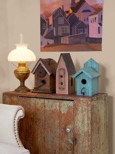 These flea-market find birdhouses echo the rooftops of the oil-painting above.