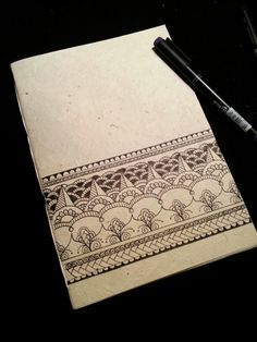 Diy notebook in rice paper. Zentangle illustration. Indian inspiration