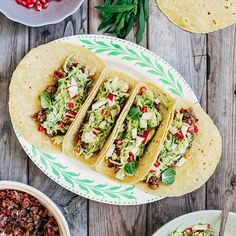 Tacos with Aromatic Red Rice, Brussels Sprout Slaw and Creamy Tarragon-Orange Dressing | Besides the concept of filling a tortilla shell with various ingredients, not much is left of traditional tacos in this recipe. These tacos are vegan, but they are so full of bright and warming flavors that you'll hardly notice.