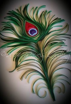 A quilled peacock feather by Mainely Quilling.