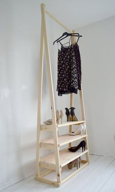Natural Wood Clothes Rack with Shelves! Can be painted in various ways, just contact me via Etsy with the colour choice of yours. Dimensions: Height : 200 cm Width: 85 cm Length: 35 cm Gap between the top rung and top shelf: 140 cm Shelves depth: 36 cm (bottom) , 33 cm (middle) , 28.5 cm (top) Distance from the ground to the shelf: 20 cm to the bottom shelve 40 cm to the middle shelve 60 cm to the top shelve 20 cm spaces between the shelves Hand Made. It is quick and easy to assemble...