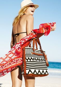 This bold graphic print tote is sure to be standout essential this summer.