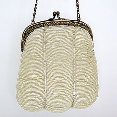 Vintage beaded bridal purses & wedding handbags by Moyna.  Ivory beaded purse for your essentials. Find your style at Perfect Details.