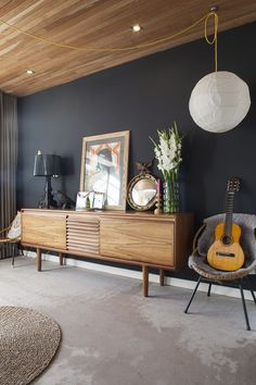 Use of wood as an Accent/ Pop of color. Subtle colors in accessories, thoughts? Like the dark wall for contrast with some elements.  Console