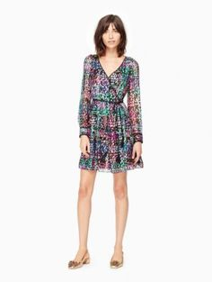 made from a colorful polka-dotted silk, this pretty wrap dress is tailor-made for holiday parties. add a pair of low, metallic heels and hit the dancefloor!