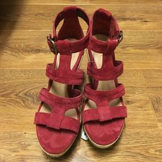 Ugg suede sandals Brand new red suede sandals no tags I bought them for $149  I love them . It's to high for me UGG Shoes Wedges