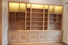 Unpainted fitted bookcase with LED light under the pelmet (Clapham)