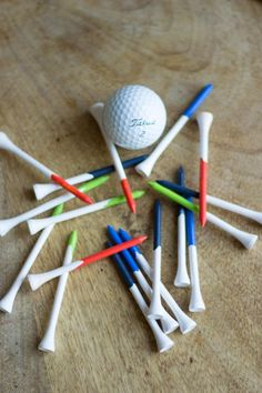 Paint dipped Golf Tees... Pictures at a golf course wedding? www.pont-roche.com