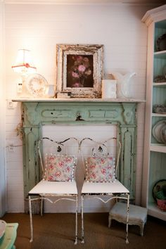 A #fireplace #mantel with wonderful chippy green paint.
