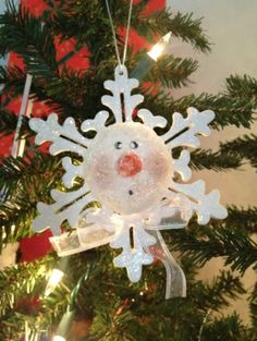 Snowman ornament. Made from dollar store snowflake and a cut in half styrofoam ball painted like a snowman. by Becknboys