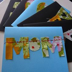 handmade cards with fabric sewn on paper