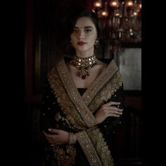 Black Benarasi saree accessorised with a stunning uncut diamond necklace. The necklace is strung together with emeralds, tourmalines, Japanese cultured pearls, turquoise and coral beads. Jewellery Courtesy: Sabyasachi Heritage Jewelry For all jewellery related queries, kindly contact sabyasachijewelry@sabyasachi.com #Sabyasachi #SpringSummer2018 #SS18 #DestinationWeddings #SabyasachiJewelry #TheWorldOfSabyasachi @bridesofsabyasachi