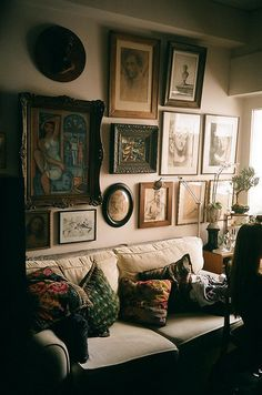 I love how a European decorating style lets you cover a wall with art.