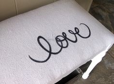 "bench makeover: recovered with drop cloth and sharpie drawn ""love"""