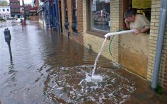 Sveinn Storm pumps water out of his flooded Storm Bros Ice Cream Factory shop in Annapolis, Maryland - Picture: Blake Sell/AP